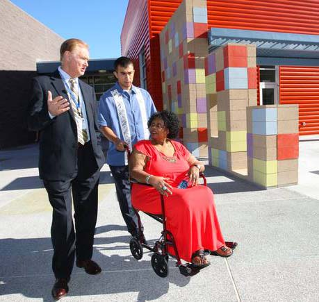 Clark County School District Superintendent Walt Rulffes walks the campus with namesake Ruby Duncan and Michael Flores, 22, during the school's opening day.(Photo credit: Mona Shield Payne, Las Vegas Sun.